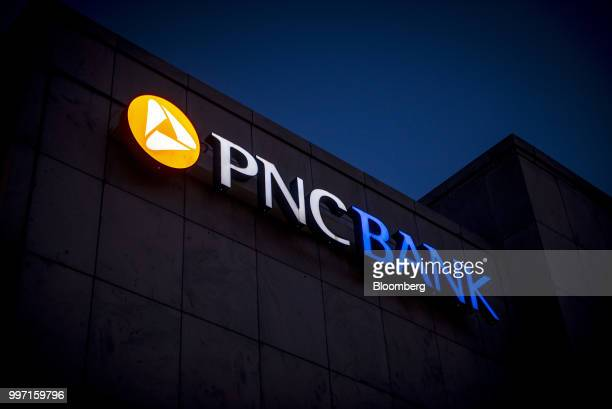 Signage is illuminated outside a PNC Financial Services Group Inc bank branch at night in Chicago Illinois US on Tuesday July 10 2018 PNC Financial...