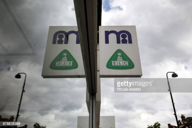 Signage is pictured at a Mothercare shop on Wood Green High Street in north London on June 19 2018 Major UK retailers are increasingly facing tough...