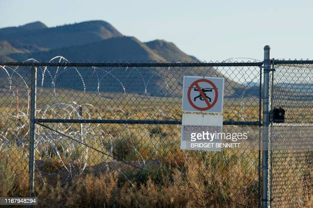 Signage is posted outside a gate of the Nevada Test and Training Range commonly referred to as Area 51 near Rachel Nevada on September 13 2019 A joke...
