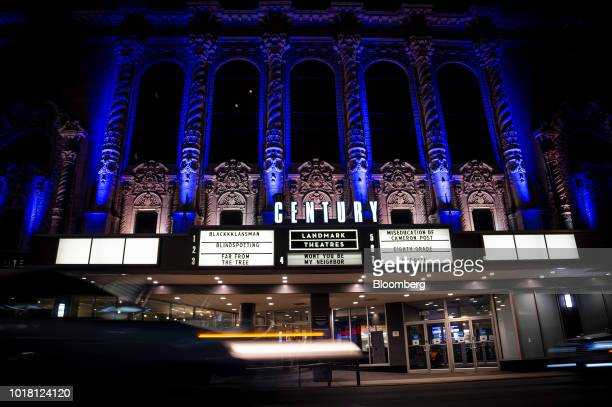 Signage is seen above a movie poster displayed outside of the Landmark Century Centre Cinema in Chicago Illinois US on Thursday Aug 16 2018 Amazoncom...
