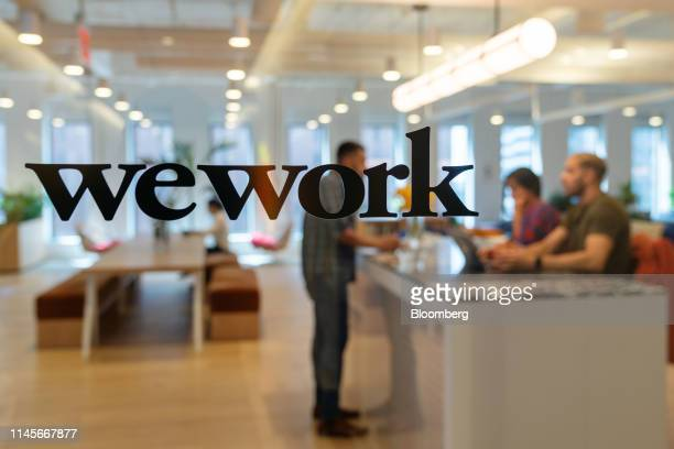 Signage is seen at the entrance of the WeWork Cos Inc. 85 Broad Street offices in the Manhattan borough of New York, U.S., on Wednesday, May 22,...