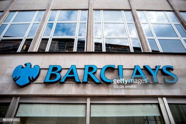 Signage is seen at the front of a branch of Barclays bank in central London on October 22 2017