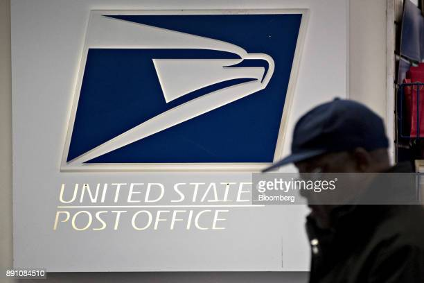 Signage is seen at the United States Postal Service Joseph Curseen Jr and Thomas Morris Jr post office station in Washington DC US on Tuesday Dec 12...