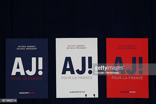 Signage is seen before Alain Juppe, Mayor of Bordeaux and Les Republicains presidential candidate hopeful, speaks during a meeting at Palais des...