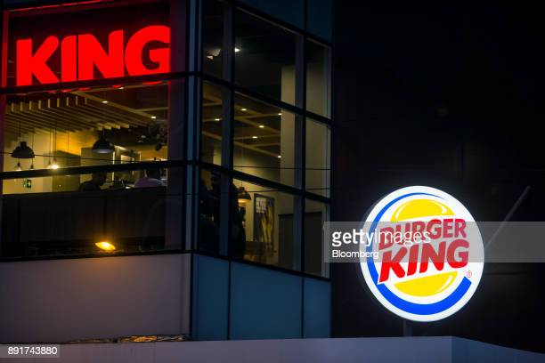 Signage is seen illuminated at night outside of a Burger King do Brasil restaurant on Paulista Avenue in Sao Paulo, Brazil, on Monday, Dec. 11, 2017....