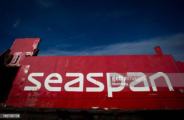 Signage is seen on a barge at the Seaspan Vancouver Shipyard in North Vancouver British Columbia Canada on Wednesday Oct 9 2013 Canadian Public Works...