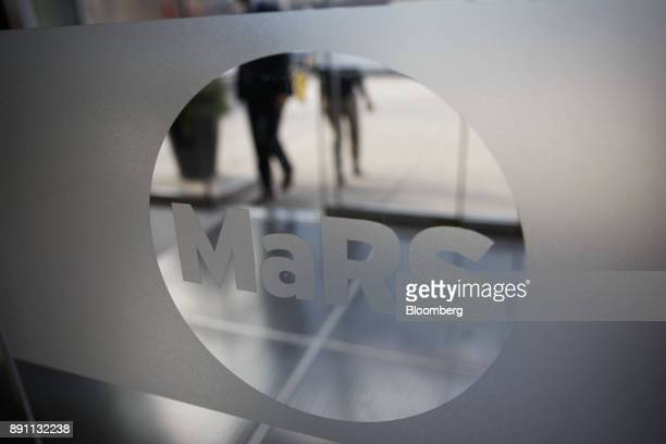 Signage is seen on the door to the MaRS Discovery District in Toronto Ontario Canada on Monday Dec 4 2017 A halfcentury ago Canadian scientists...
