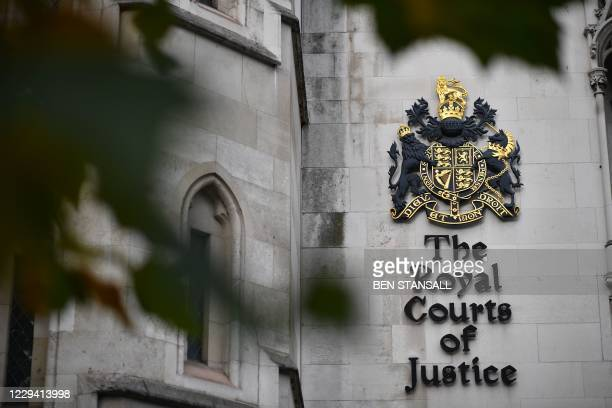 Signage is seen on the side of the Royal Courts of Justice where the High Court is located in London on November 2, 2020. - Hollywood star Johnny...