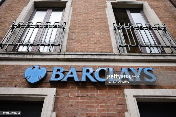Signage is seen outside a branch of British bank Barclays in central London on July 28, 2021. - British bank Barclays said Wednesday that first-half...