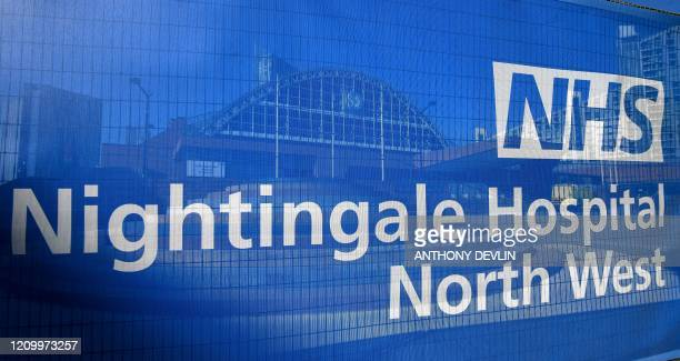 Signage is seen outside the Nightingale Hospital North West the converted Manchester Central Convention Complex in Manchester northwest England on...
