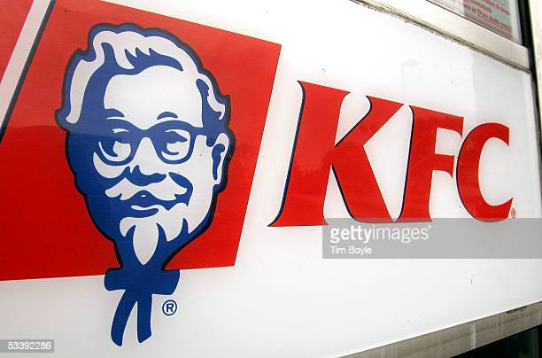 KFC signage is visible on a door of a cigarettesmokefree companyowned KFC restaurant August 15 2005 in Chicago Illinois Louisville Kentuckybased Yum...