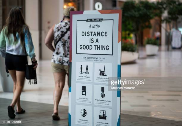 Signage notes new social distancing rules and procedures in the Mall of America on June 10, 2020 in Minneapolis, Minnesota. Today marks the first day...