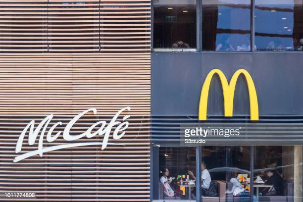 Signage of McDonald's and McCafe a coffeehousestyle food and drink chain owned by McDonald's are seen in Hong Kong Hong Kong on August 02 2018...