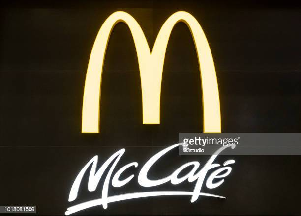 Signage of McDonald's and McCafe are seen at Shanghai Pudong International Airport on August 10 2018 in Shanghai China
