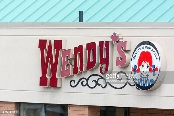 Signage of Wendy's fast food restaurant in Canada with two of the letters in pink while the rest in red the apostrophe replaced by a pink maple leaf