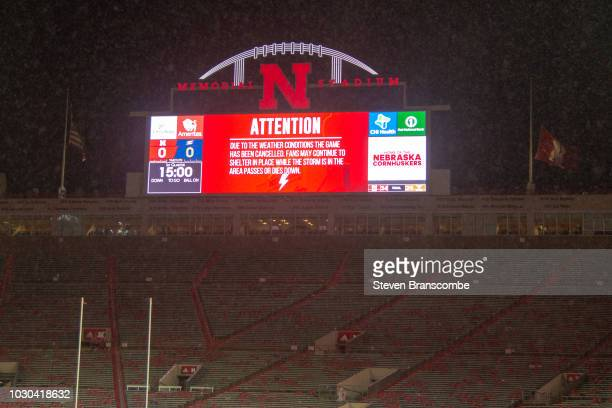 Signage on the scoreboard indicating the game between the Nebraska Cornhuskers and the Akron Zips has been cancelled at Memorial Stadium on September...