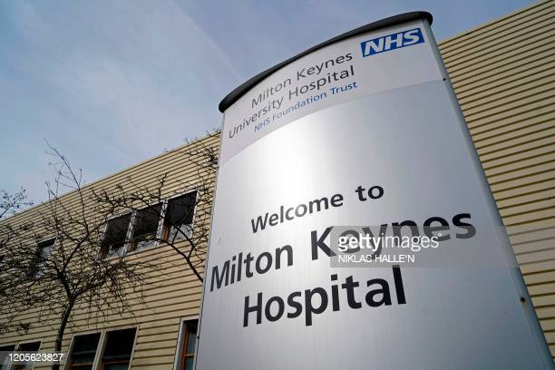 Signage outside Milton Keynes University Hospital, where a man who tested positive for coronavirus and had underlying health conditions, died on...