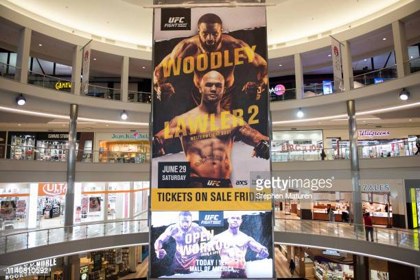 Signage promotes the upcoming fight between Tyron Woodley and Robbie Lawler during the UFC Fight Night Open Workouts event at the Mall of America on...