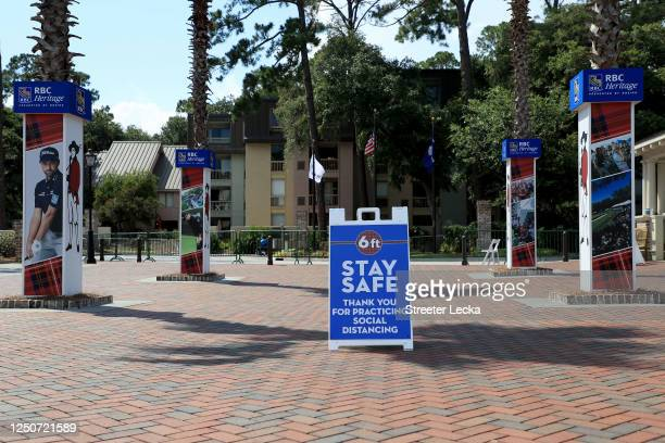 Signage promoting social distancing is displayed as a COVID-19 precaution during the second round of the RBC Heritage on June 19, 2020 at Harbour...