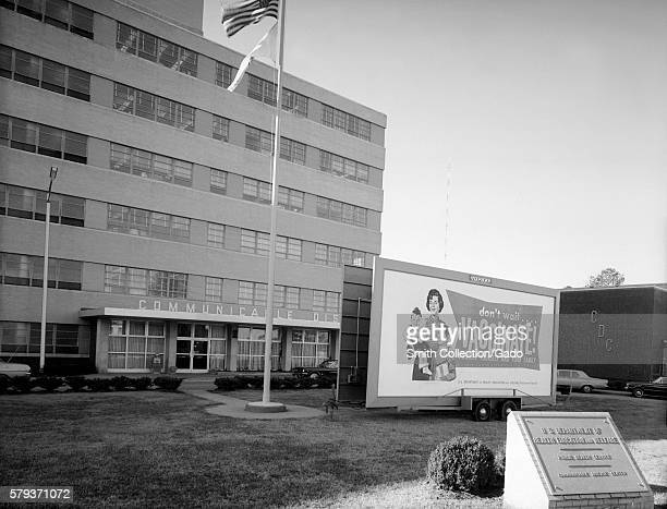 Signage promoting vaccination at the CDC Clifton Road Offices Atlanta Georgia 1973 Front view of CDC Building 1 and signage promoting vaccination...