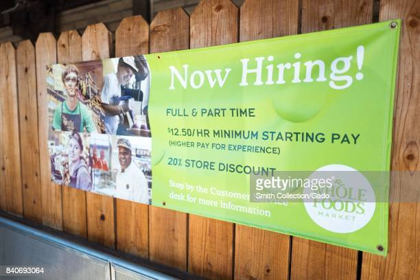 Signage reading 'Now Hiring' at the Whole Foods Market store in Lafayette California August 28 2017 On August 28 Amazon completed its acquisition of...