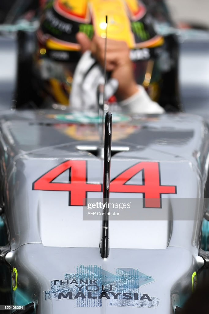 A signage reading ' Thank you Malaysia ' is seen on Mercedes's British driver Lewis Hamilton's car during the second practice session of the Formula One Malaysia Grand Prix in Sepang on September 29, 2017. /