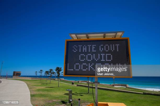 Signage regarding lockdown restrictions are set up along beaches across Perth as temperatures reach 38 degrees Celsius as the five-day lockdown...
