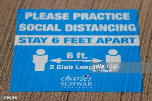 Signage reminds people to practice social distancing at a mobile testing unit prior to the Charles Schwab Challenge on June 09, 2020 in Fort Worth,...