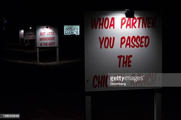 Signage stand outside of the Chicken Ranch brothel in Pahrump Nevada US on Thursday Jan 26 2012 The Nevada Republican presidential caucus will be...