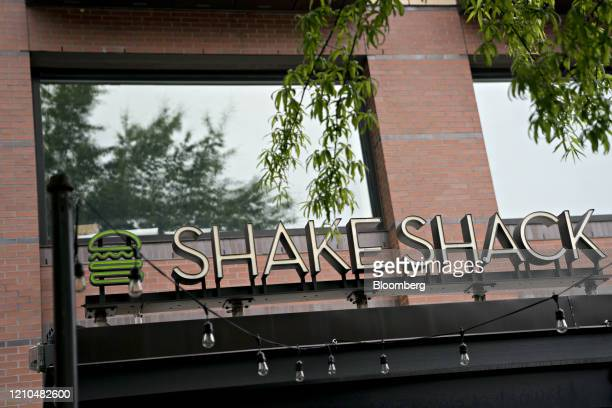 Signage stands at a Shake Shack restaurant in Washington, D.C., U.S., on Monday, April 20, 2020. Shake Shack Inc. Will return a $10 million loan from...
