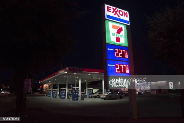 Signage stands illuminated at night at an Exxon Mobil Corp gas station in Dallas Texas US on Monday July 24 2017 Exxon Mobil Corp is scheduled to...