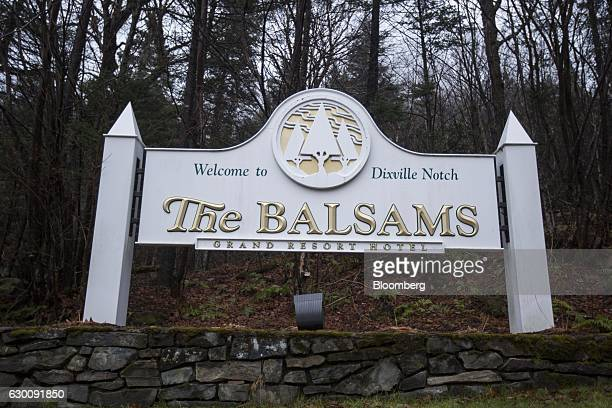 Signage stands on display outside the Balsams Resort in Dixville Notch New Hampshire US on Thursday Nov 17 2016 Les Otten founder of American Skiing...