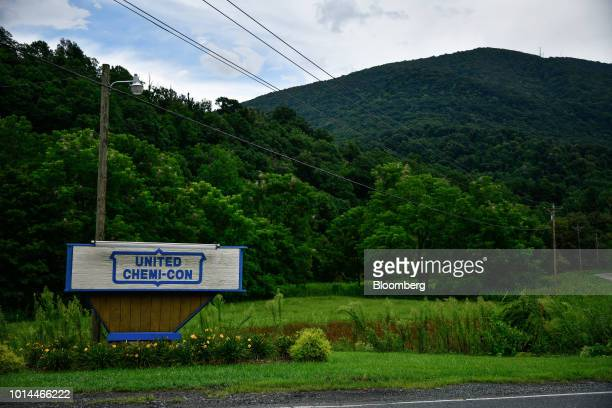 Signage stands on display outside the United ChemiCon Inc aluminum electrolytic capacitors production facility located in a foreigntrade zone in...