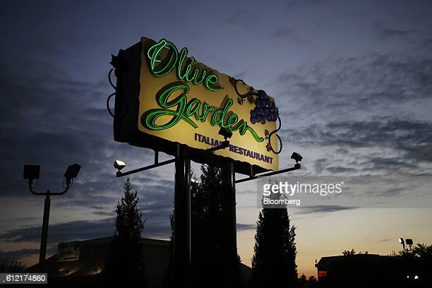 Signage stands outside a Darden Restaurants Inc Olive Garden location in Louisville Kentucky US on Wednesday Sept 28 2016 Darden Restaurants Inc is...