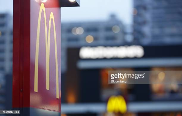 Signage stands outside a McDonald's restaurant operated by McDonald's Holdings Co Japan Ltd in Tokyo Japan on Saturday Feb 6 2016 McDonald's Japan is...