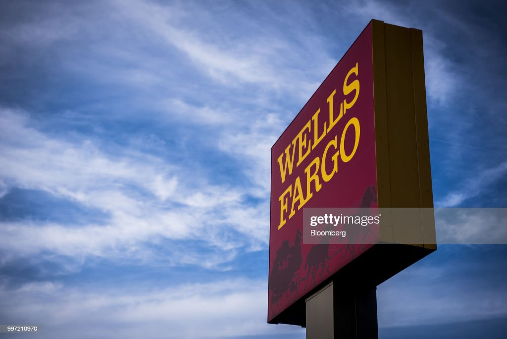 Signage stands outside a Wells Fargo & Co. bank branch in Evanston, Illinois, U.S., on Tuesday, July 10, 2018. Wells Fargo & Co. is scheduled to release earnings figures on July 13. Photographer: Christopher Dilts/Bloomberg via Getty Images
