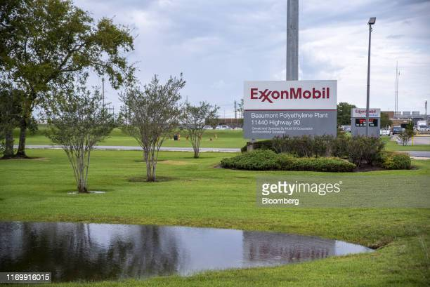 Signage stands outside the Exxon Mobil Corp Beaumont Polyethylene Plant following Tropical Storm Imelda in Beaumont Texas US on Friday Sept 20 2019...