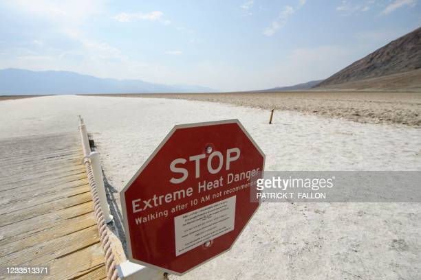Signage warns of extreme heat danger at the salt flats of Badwater Basin inside Death Valley National Park on June 17, 2021 in Inyo County,...