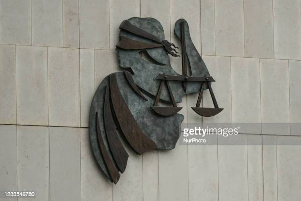 Signage with Lady Justice insignia at the entrance to the Criminal Courts of Justice in Dublin. On Thursday, 17 June 2021, in Dublin, Ireland.