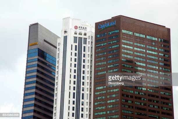 Signages for Malayan Banking Bhd left Bank of China Ltd center and CapitaLand Ltd are display on the company's buildings in the central business...