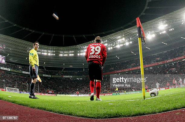 A signal flare thrown from Koeln fans is seen as Toni Kroos of Leverkusen prepares to execute a corner kick during the Bundesliga match between Bayer...