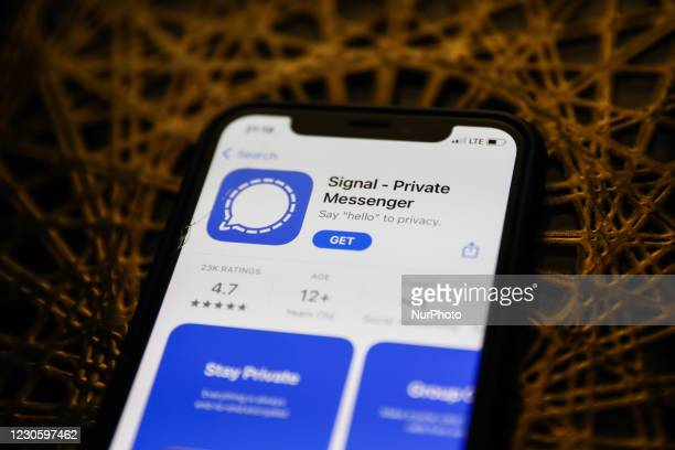 Signal logo on the App Store is seen displayed on a phone screen in this illustration photo taken in Poland on January 14, 2021. Signal and Telegram...