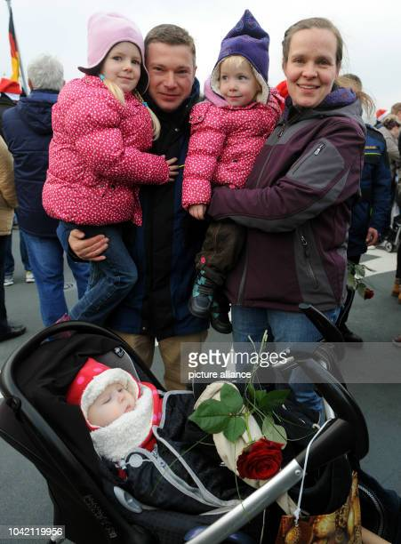 Signal master SteffenWusch is greeted by his daughter Any Nayaand his wife Annika Janke after frigate Niedersachsen docked after returning from a...