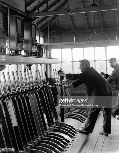 Signalman at work in the signal box at Harrow London North Western Railway 1906 Signal boxes such as this were usually manned 24 hours a day