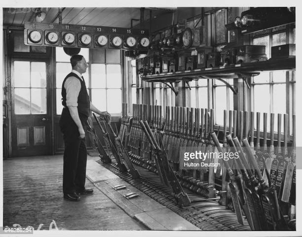 A signalman operates levers which control the down side of King's Cross Station its suburban platforms and the station's yard from the west signal...