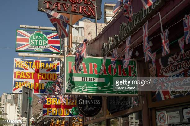 Signals announcing British food and leisure offers are seen on July 21 2019 in Benidorm Spain More than 39 million of tourists are expected to visit...
