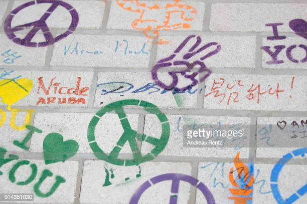 Signature of International Olympic Committee President Thomas Bach is pictured on a piece of the 'Building Bridges' mural are oictured during the...
