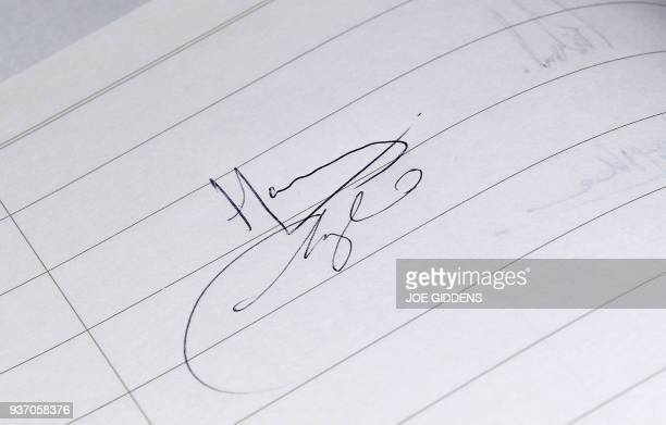 Signatures are pictured in the visitors book signed by Britain's Prince Harry and Prince Harry's fiancee US actress Meghan Markle during a visit to...