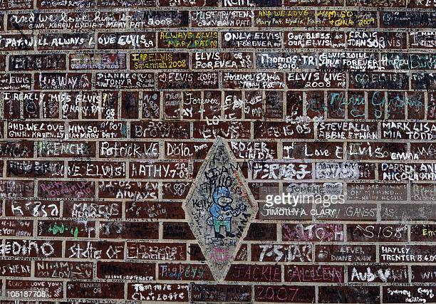 Signatures left by thousands of Elvis Presley fans left on the wall over the years at Graceland Mansion August 16 his residence in Memphis Elvis died...