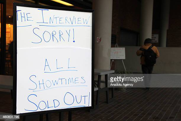 A signboard is seen in front of the West End Cinema where the tickets for the screening of Sony Pictures' 'The Interview' are all sold out for the...